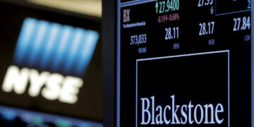 The ticker and trading information for Blackstone Group is displayed at the post where it is traded on the floor of the New York Stock Exchange (NYSE) April 4, 2016.