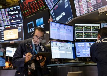 Trader Trader Gregory Rowe works on the floor of the New York Stock Exchange at the end of the trading day Monday, March 16, 2020. (AP Photo/Craig Ruttle)