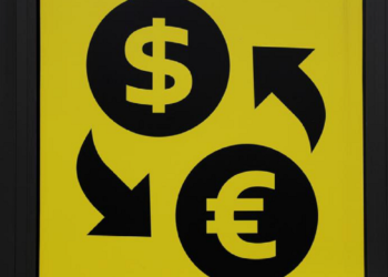 Currency signs of the U.S. dollar and Euro are seen at a currency exchange office in Kiev, Ukraine