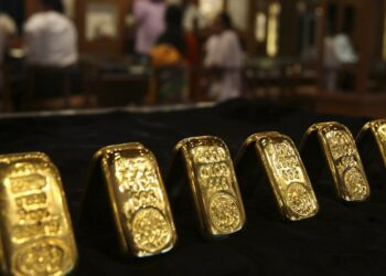 Gold slips on firmer dollar