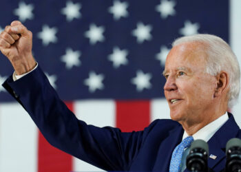 FILE PHOTO: Democratic U.S. presidential candidate and former Vice President Joe Biden thrusts his fist while answering questions from reporters during a campaign event in Wilmington, Delaware, U.S., June 30, 2020. REUTERS/Kevin Lamarque/File Photo