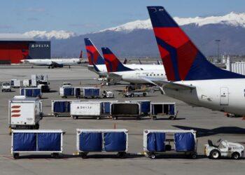 FILE PHOTO: Delta Airlines planes are loaded and unloaded as travel has cutback amid concerns of the coronavirus disease (COVID-19), at Salt Lake City International Airport in Salt Lake City, Utah, U.S. April 14, 2020. REUTERS/Jim Urquhart