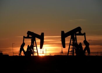 Pump jacks operate at sunset in an oil field in Midland, Texas U.S. August 22, 2018.