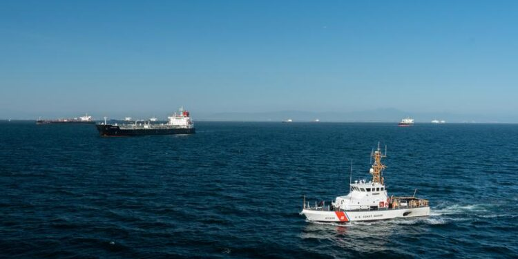 Coast Guard Cutter Narwhal patrols near some of the 27 oil tankers anchored off shore during the outbreak of the coronavirus disease (COVID-19) in Long Beach, California, U.S., April 23, 2020.