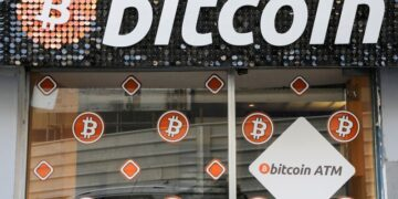 A Bitcoin digital currency ATM shop is seen in Marseille