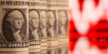 U.S. One dollar banknotes are seen in front of displayed stock graph in this illustration taken, February 8, 2021.
