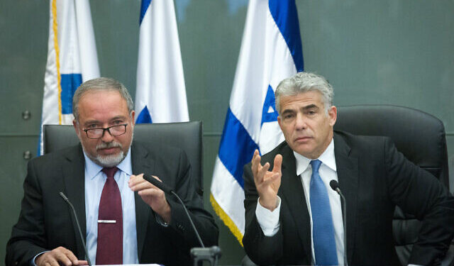 Leader of the Yesh Atid political party, Yair Lapid, and leader of the Yisrael Beyteinu party Avigdor Liberman, lead a joint conference in the Israeli parliament regarding Israel's foreign policy. February 29, 2016. Photo by Miriam Alster/FLASH90 *** Local Caption *** ???? ???? ???? ?? ???? ????? ?????? ??????? ??????