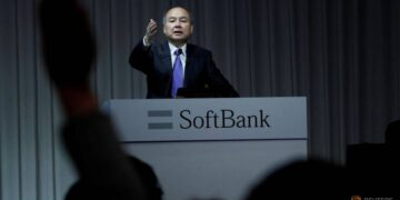 A journalist raises her hand to ask a question to Japan's SoftBank Group Corp Chief Executive Masayoshi Son during a news conference in Tokyo, Japan, November 5, 2018.